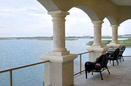 p-2CaneHarbor0917--PHOTO BY EDDIE SEAL/SPECIAL TO THE CALLER TIMES--The second story veranda overlooking Lake Padre and Packery Channel at the Burkett's home on Cane Harbor Bay Dr.  (9/11/06 es)